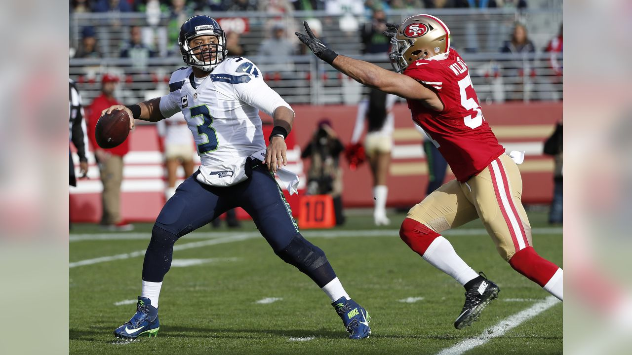 Seattle Seahawks quarterback Russell Wilson (3) passes as San Francisco  49ers linebacker Michael Wilhoite 7e16b2ec7