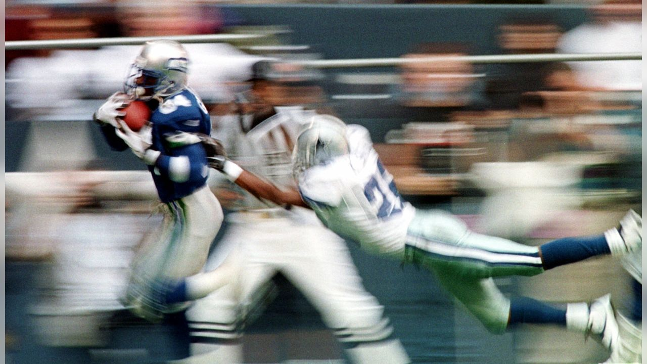 Seattle Seahawks receiver Joey Galloway (84) pulls in a 44-yard touchdown pass as Dallas Cowboys' Kevin Smith (26) defends on the play during the second quarter in Irving, Texas, Sunday, Nov. 22, 1998. (AP Photo/Bill Janscha)