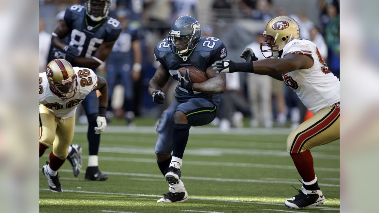 Seattle Seahawks running back Julius Jones runs with the ball during an NFL  football game against 2ea670f91