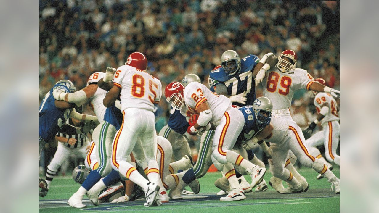 Running back Barry Word (23) of the Kansas City Chiefs runs past Cortez  Kennedy 482d508e8