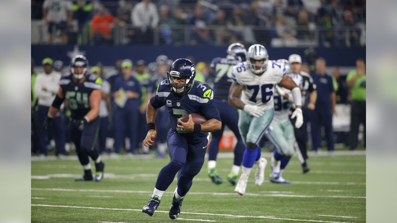97d1ecc78 Seattle Seahawks quarterback Russell Wilson (3) finds running room as Dallas  Cowboys defensive end