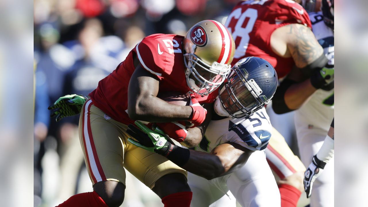 San Francisco 49ers running back Frank Gore (21) is tackled by Seattle  Seahawks  09256ab6f