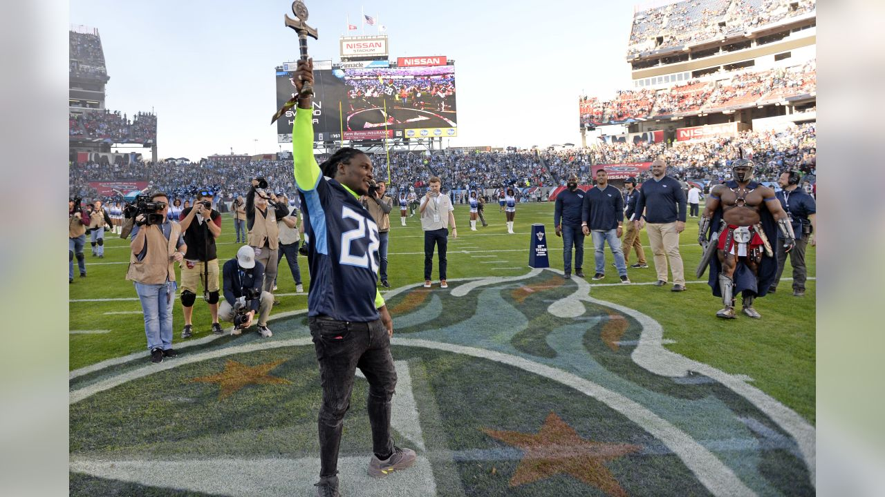 Former Tennessee Titans running back Chris Johnson serves as the team's 12th Man before an NFL football game between the Titans and the New York Jets Sunday, Dec. 2, 2018, in Nashville, Tenn. (AP Photo/Mark Zaleski)