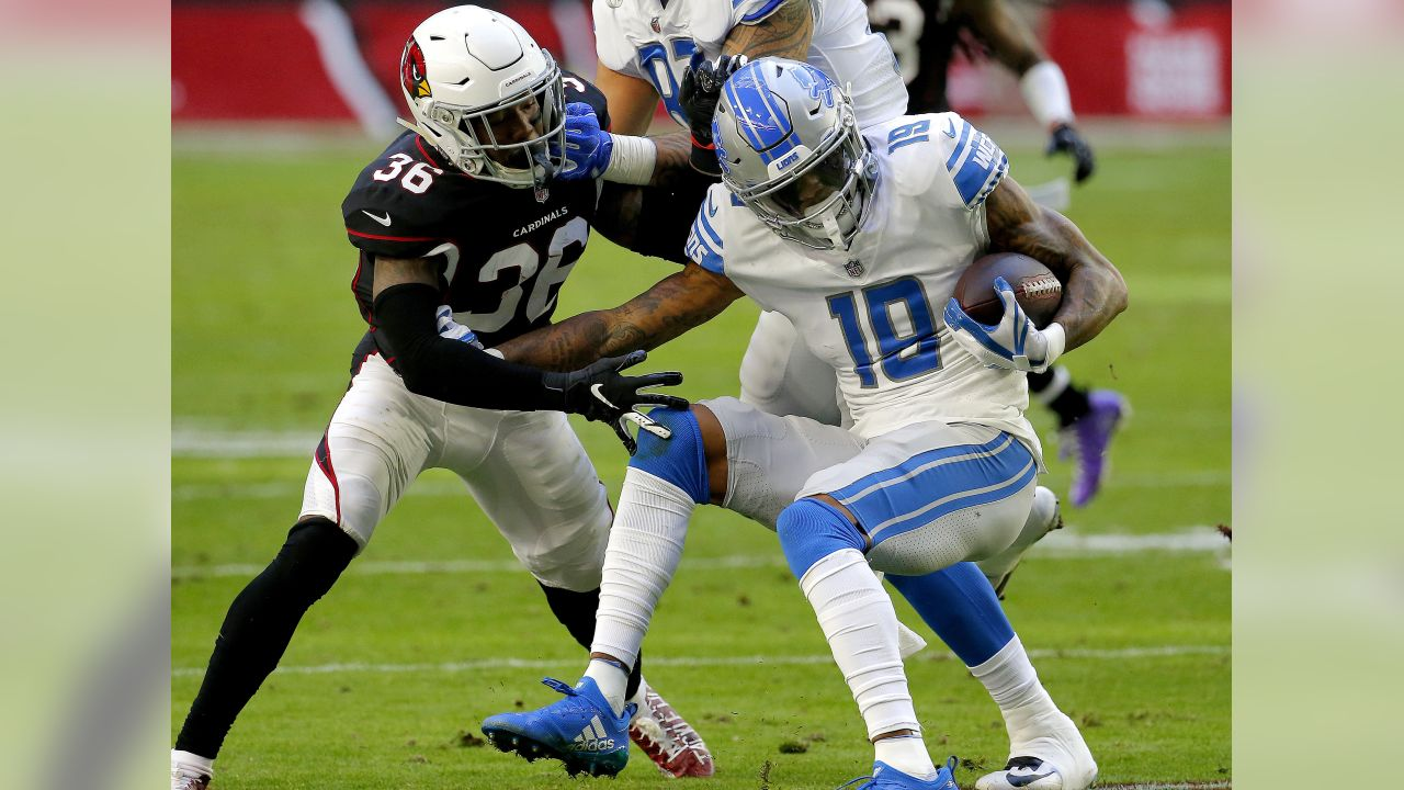 Detroit Lions wide receiver Kenny Golladay (19) is hit by Arizona Cardinals strong safety Budda Baker (36) during the first half of NFL football game, Sunday, Dec. 9, 2018, in Glendale, Ariz.