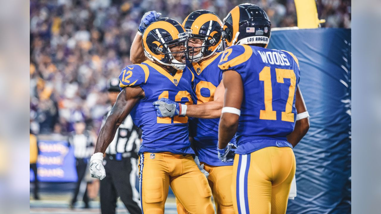 Los Angeles Rams wide receiver Brandin Cooks (12) celebrates his first Los Angeles Rams touchdown with wide receiver Cooper Kupp (18), and wide receiver Robert Woods (17) during an NFL Week 4 Football game against the Minnesota Vikings. The Thursday Night Football game was simulcast on NFL Network, FOX, and Amazon Prime Video at the Los Angeles Memorial Coliseum in Los Angeles, Calif. on September 27th, 2018 (Hiro Ueno/Rams).