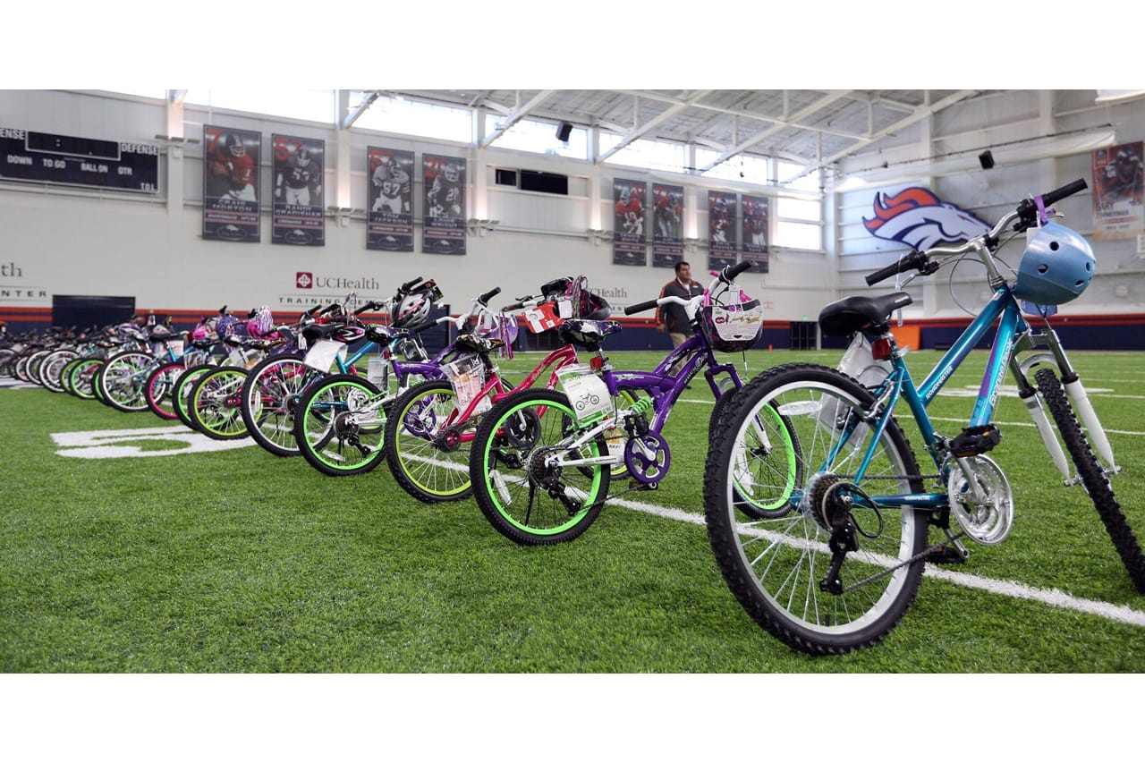 Broncos surprise Boys   Girls Club with new bikes 6d75bc78e