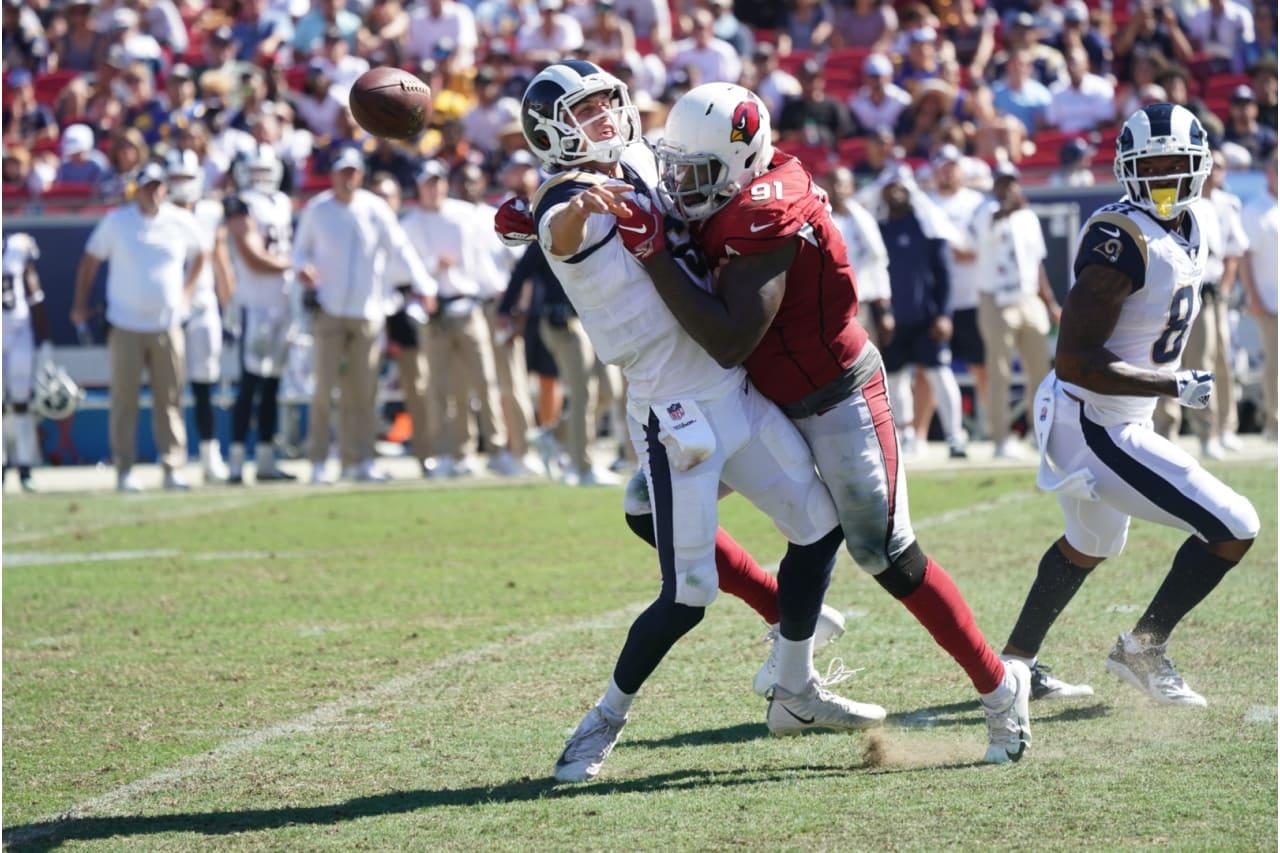 DE Benson Mayowa lays a hit on Rams QB Jared Goff