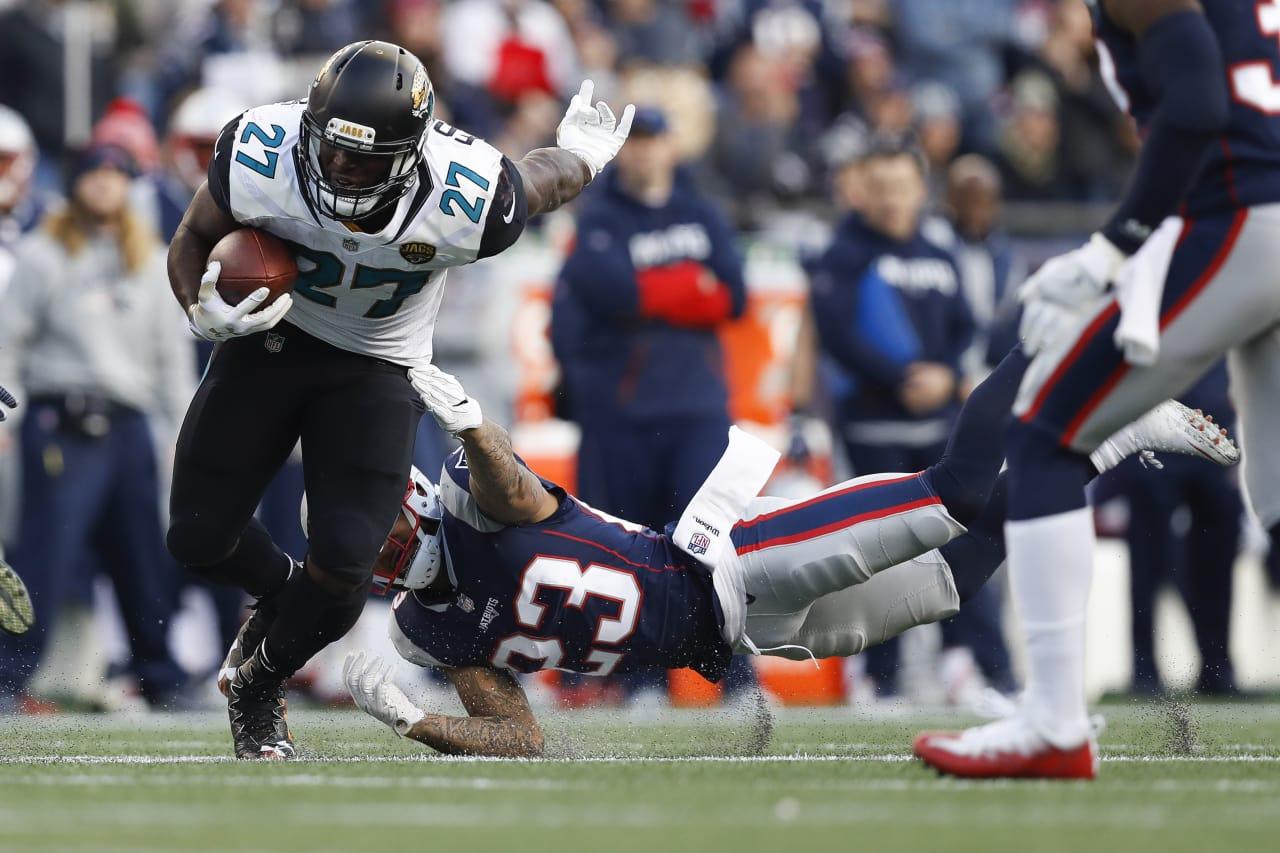 Jacksonville Jaguars Running Back Leonard Fournette (27) Carries The Ball  In Front Of New