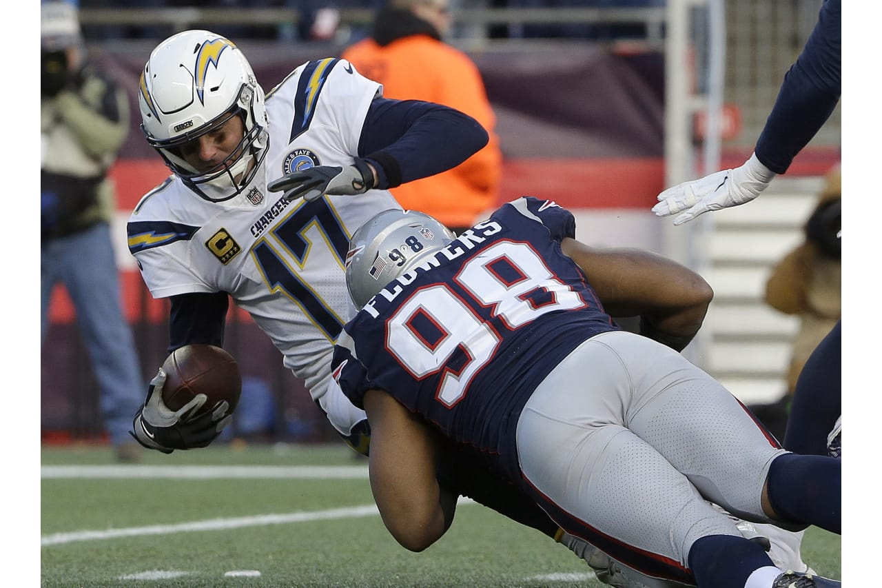 New England Patriots defensive end Trey Flowers (98) sacks Los Angeles Chargers quarterback Philip Rivers during the second half of an NFL divisional playoff football game, Sunday, Jan. 13, 2019, in Foxborough, Mass. (AP Photo/Steven Senne)