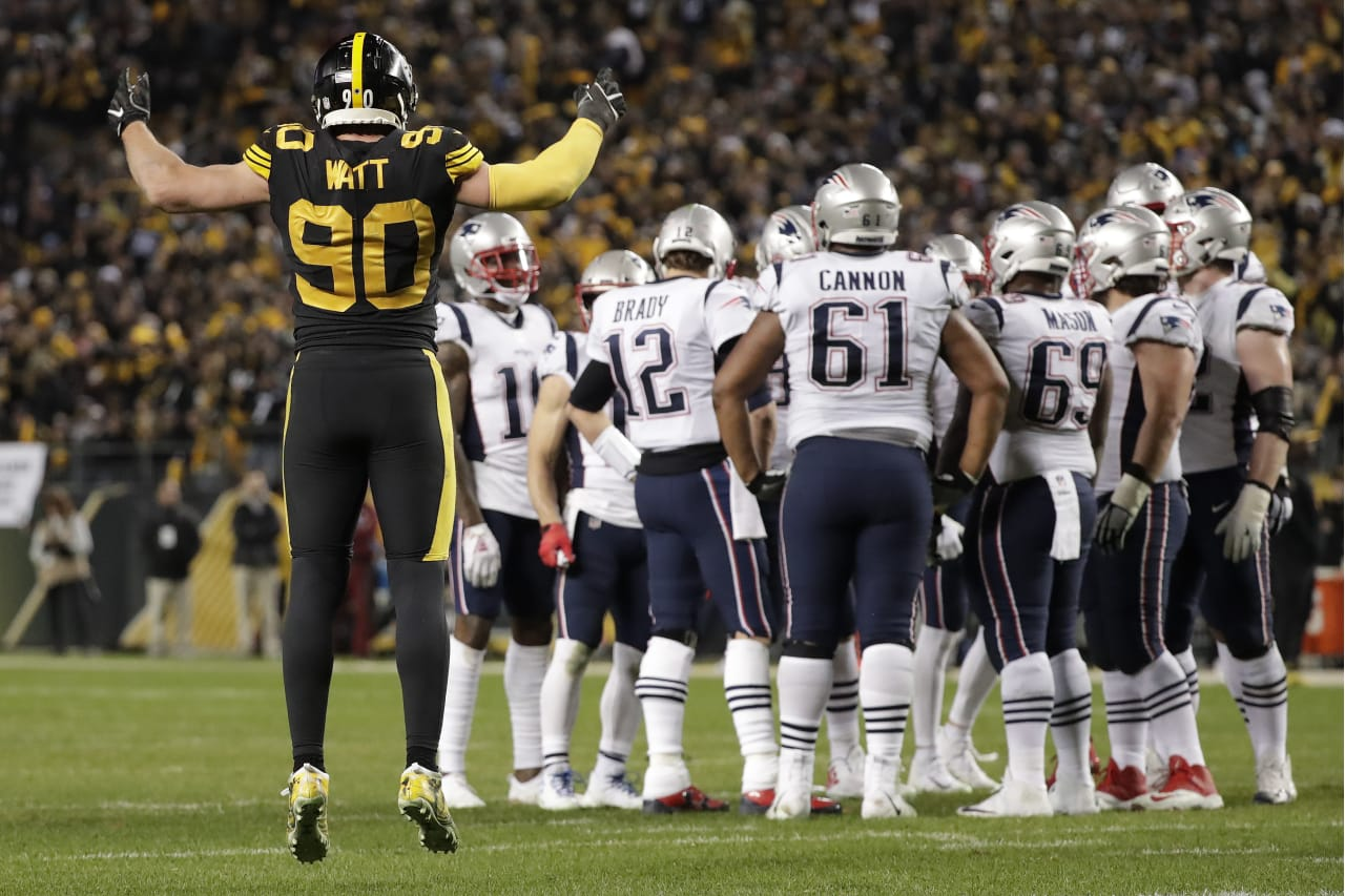 Pittsburgh Steelers outside linebacker T.J. Watt (90) calls the crowd to action as New England Patriots quarterback Tom Brady (12) huddles his team during the second half of an NFL football game in Pittsburgh, Sunday, Dec. 16, 2018. The Steelers won 17-10. (AP Photo/Don Wright)