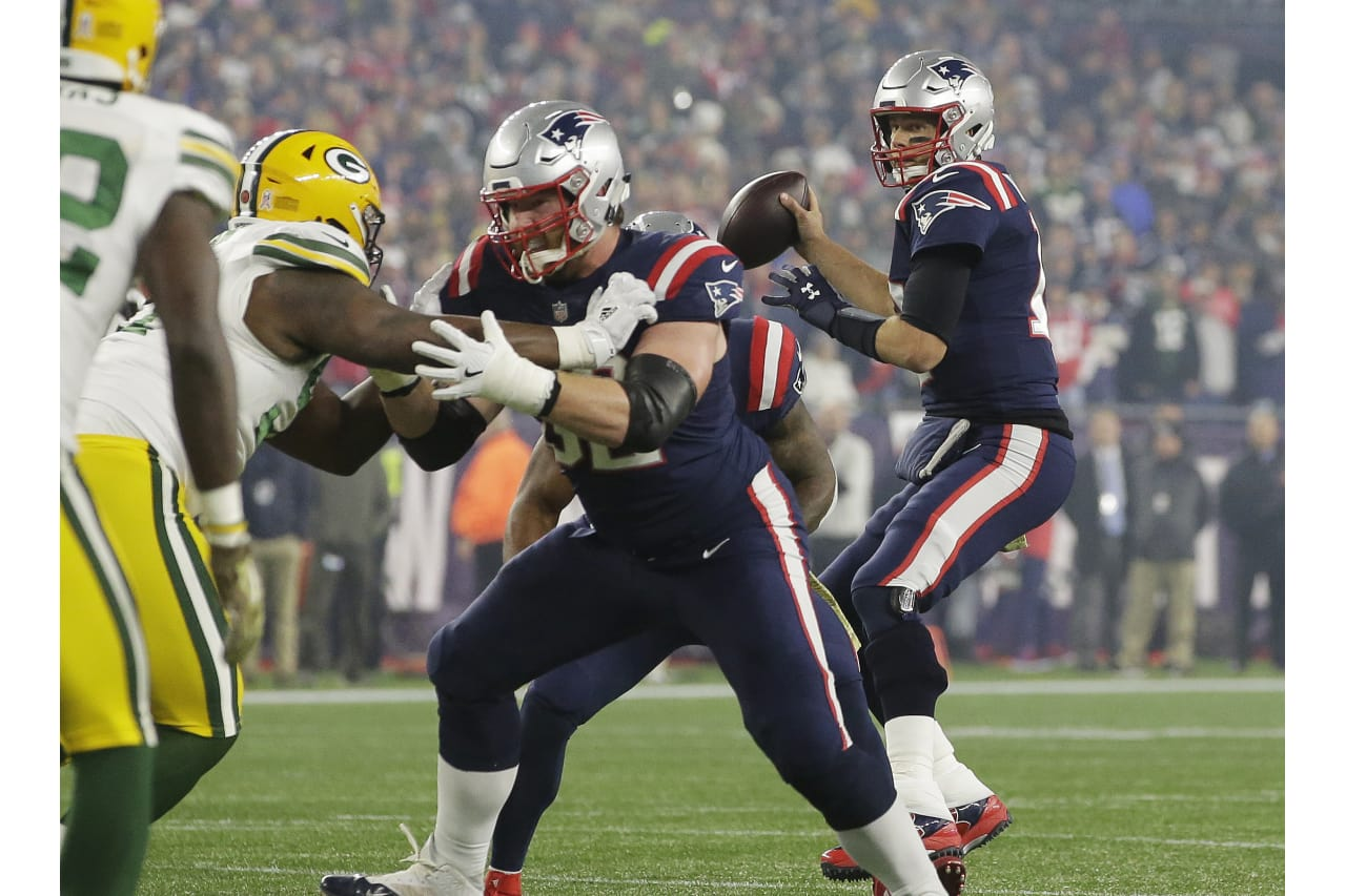 New England Patriots quarterback Tom Brady, right, looks for a receiver under pressure from the Green Bay Packers during the first half of an NFL football game, Sunday, Nov. 4, 2018, in Foxborough, Mass. (AP Photo/Steven Senne)