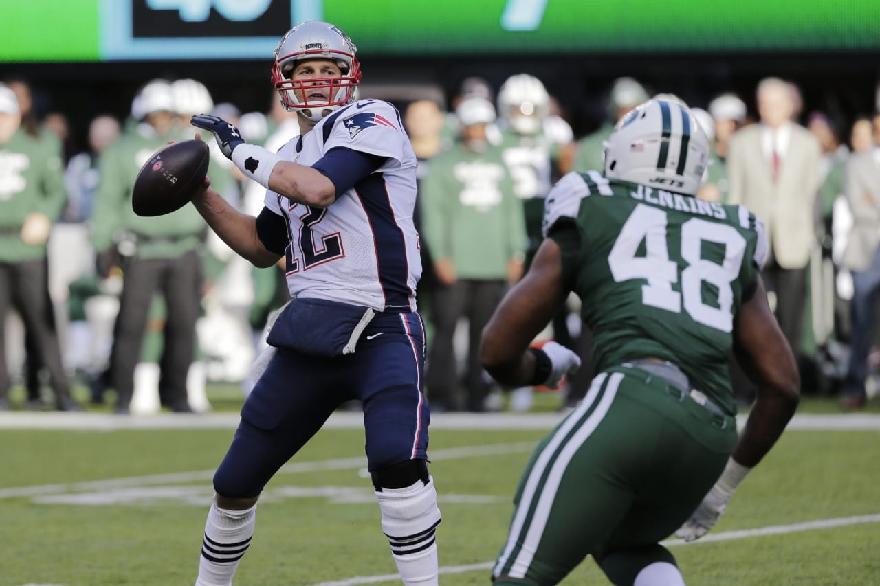 New England Patriots' Tom Brady (12) throws a pass over New York Jets' Jordan Jenkins (48) during the first half of an NFL football game Sunday, Nov. 25, 2018, in East Rutherford, N.J. (AP Photo/Seth Wenig)