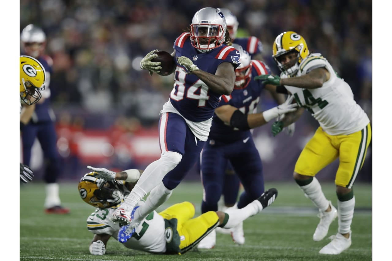 New England Patriots wide receiver Cordarrelle Patterson (84) gains yardage as a running back during the first half of an NFL football game against the Green Bay Packers, Sunday, Nov. 4, 2018, in Foxborough, Mass. (AP Photo/Charles Krupa)
