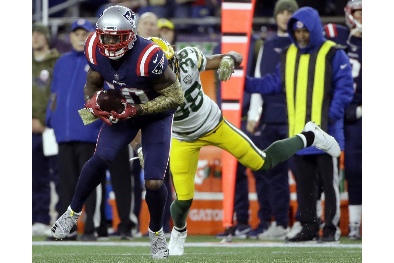 New England Patriots wide receiver Josh Gordon catches a pass in front of Green Bay Packers cornerback Tramon Williams (38) which he ran in for a touchdown during the second half of an NFL football game, Sunday, Nov. 4, 2018, in Foxborough, Mass. (AP Photo/Steven Senne)