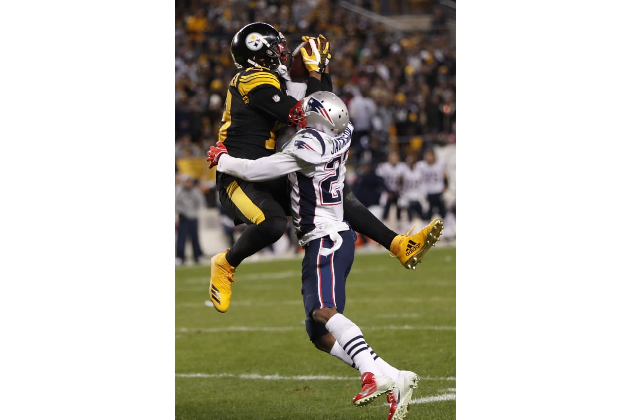 New England Patriots defensive back J.C. Jackson (27) breaks up a pass intended for Pittsburgh Steelers wide receiver JuJu Smith-Schuster (19) during the second half of an NFL football game in Pittsburgh, Sunday, Dec. 16, 2018. (AP Photo/Don Wright)