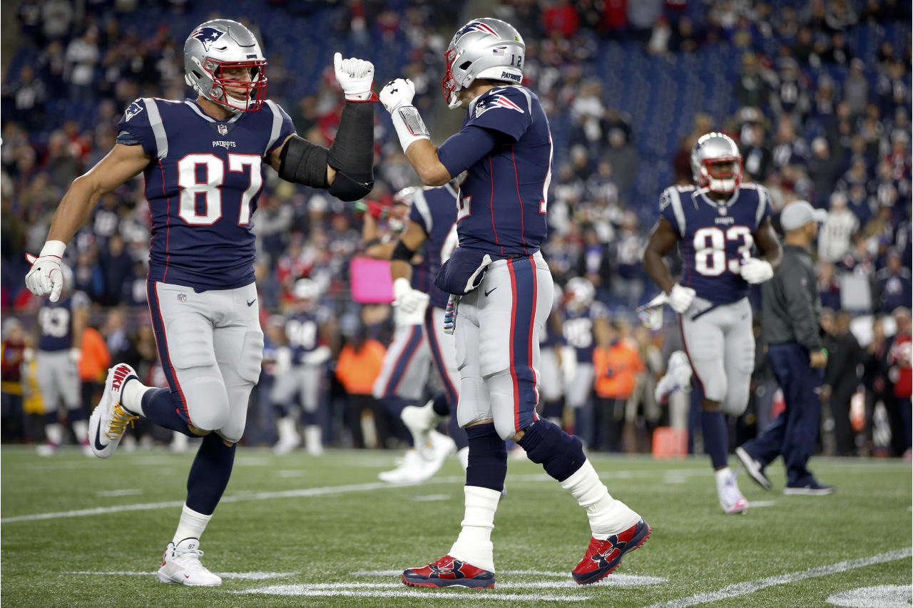 New England Patriots tight end Rob Gronkowski (87) and quarterback Tom Brady bump fists as they warm up before an NFL football game against the Kansas City Chiefs, Sunday, Oct. 14, 2018, in Foxborough, Mass. (AP Photo/Michael Dwyer)