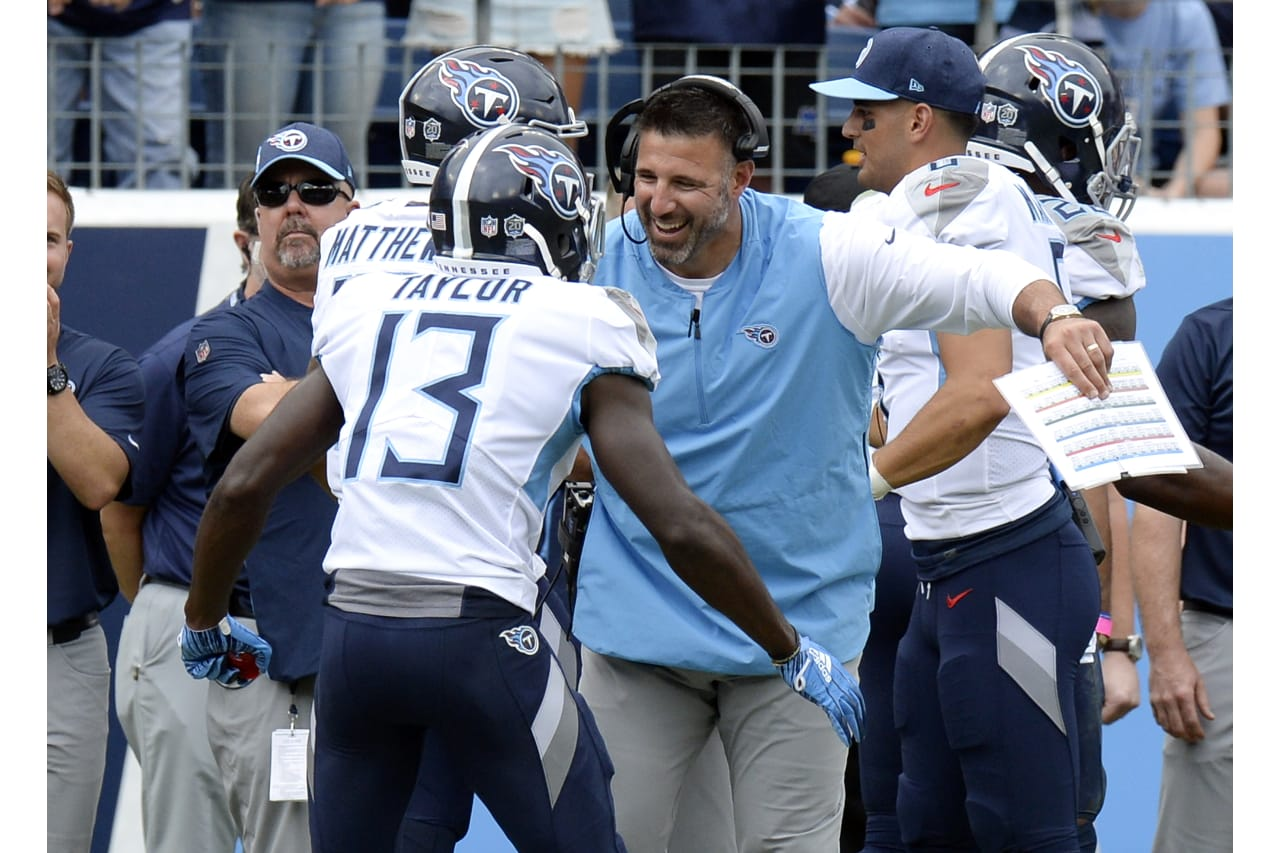 Tennessee Titans head coach Mike Vrabel celebrates with wide receiver Taywan Taylor (13) after Taylor scored a touchdown against the Houston Texans in the first half of an NFL football game Sunday, Sept. 16, 2018, in Nashville, Tenn. (AP Photo/Mark Zaleski)