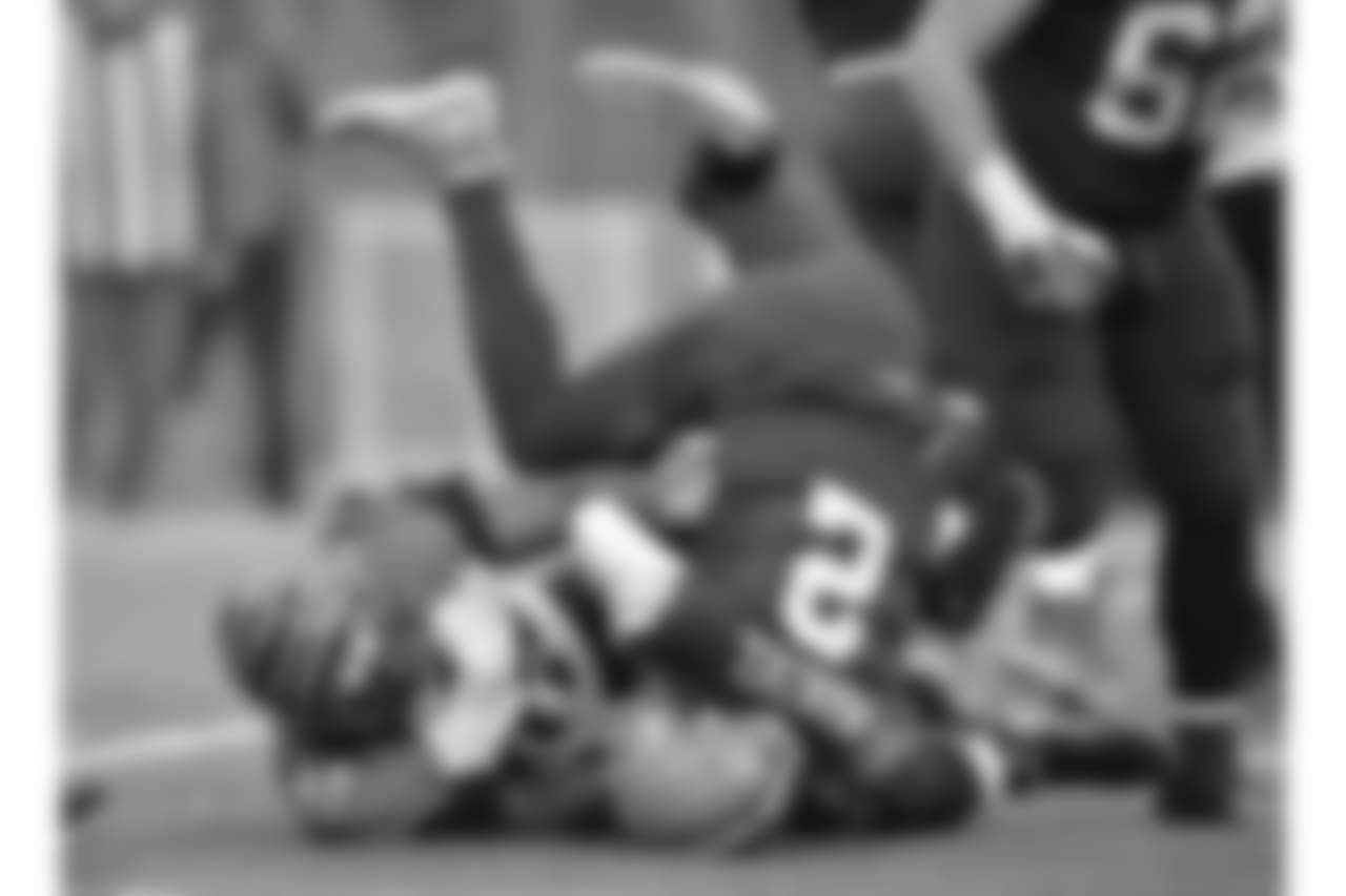 Cincinnati Bengals defensive tackle Geno Atkins (97) sacks Cleveland Browns quarterback Johnny Manziel (2) in the third quarter of an NFL football game, in Cleveland.