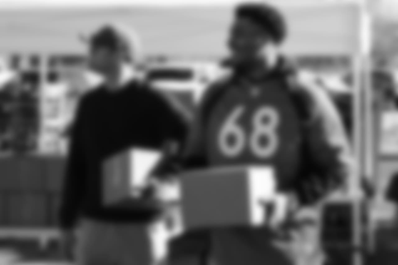 (From left) Kevin Hogan and Elijah Wilkinson during the Denver Rescue Mission's Thanksgiving Turkey in a Box distribution on Nov. 20, 2018