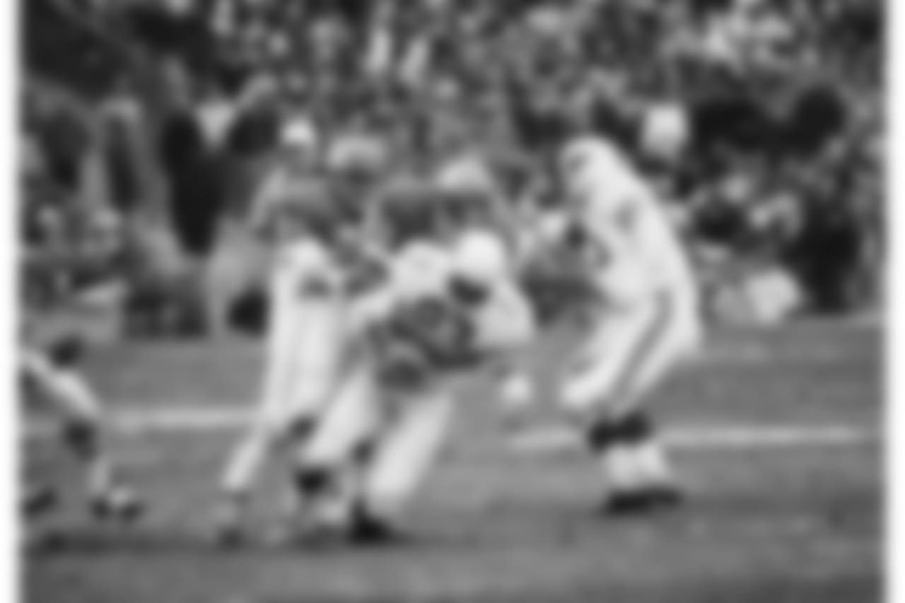 St. Louis Cardinals John Roland (23) is hauled down for no gain as Kansas City's George Daney, (#60), and Ceaser Belser (24) gang up for the tackle in Kansas City, on Nov. 23, 1970. The Chiefs and the Cardinals played to a 6-6 tie.
