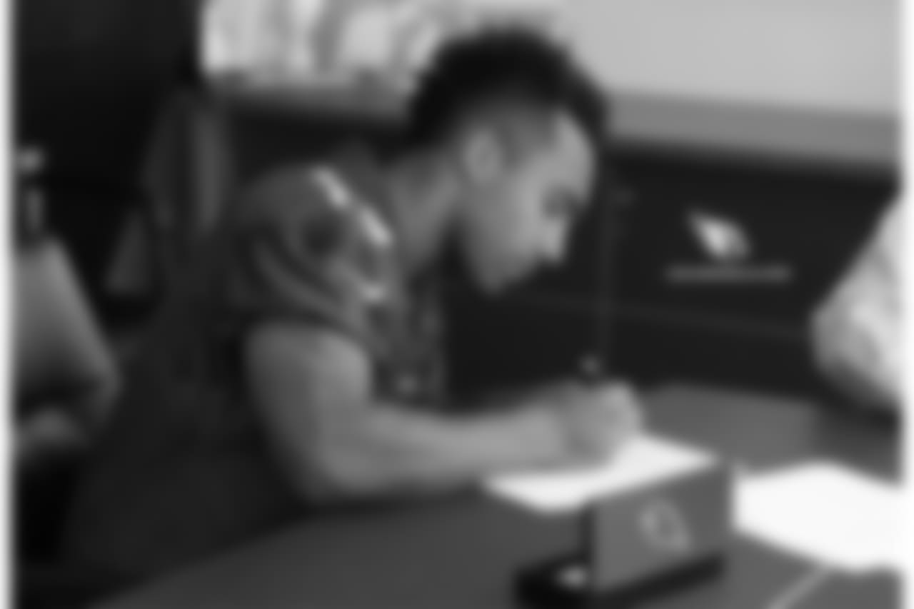 WR Christian Kirk signs his contract