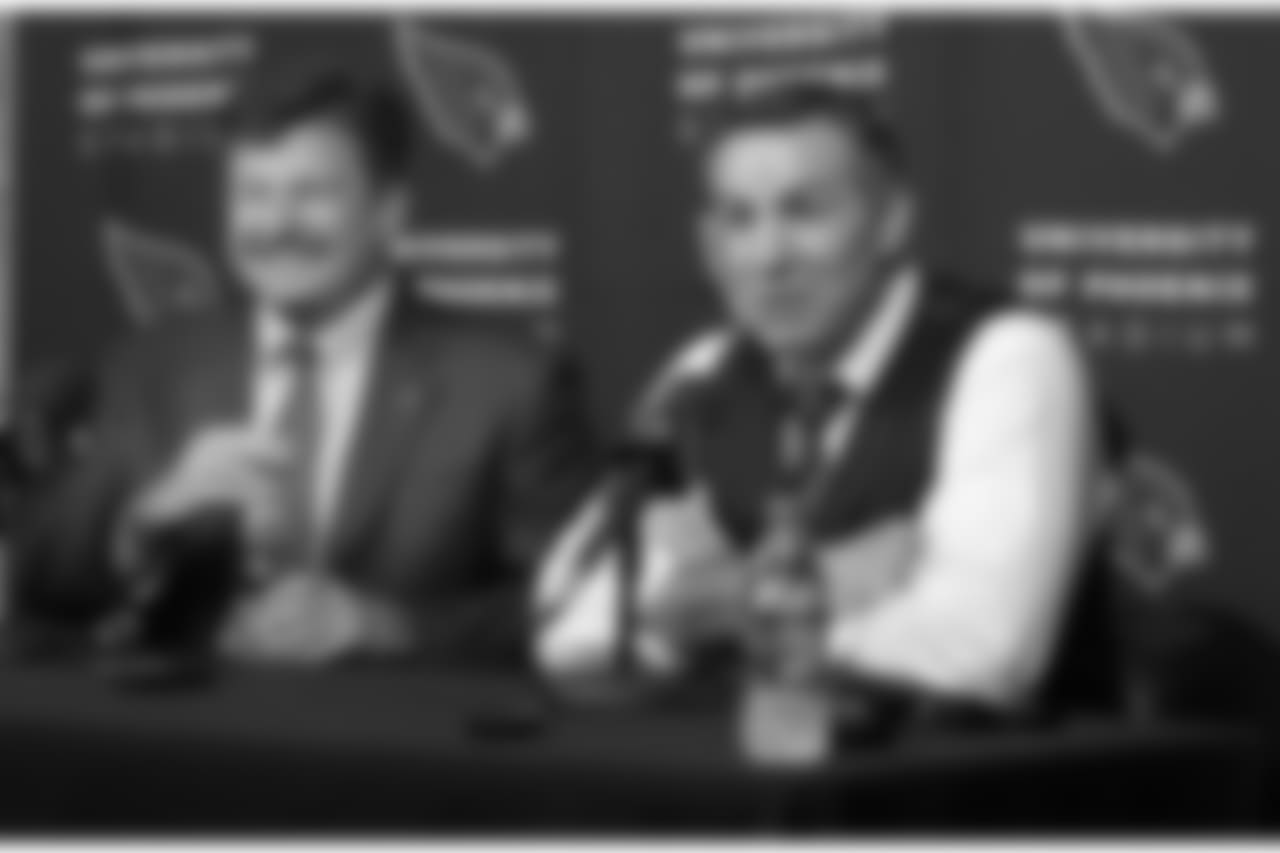 Kurt Warner (right) draws a laugh from team president Michael Bidwill during the press conference to announce Warner going into the franchise's Ring of Honor