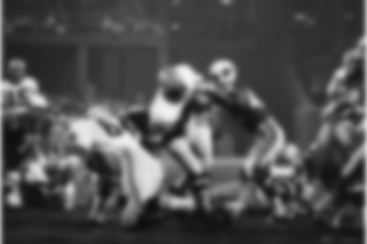 The Green Bay Packers Elijah Pitts (22) goes over from the seven in the early second quarter in St. Louis, on Monday, night, Oct. 30, 1967. Coming in too late to stop him is Jim Burson (49) of the St. Louis Cardinals.