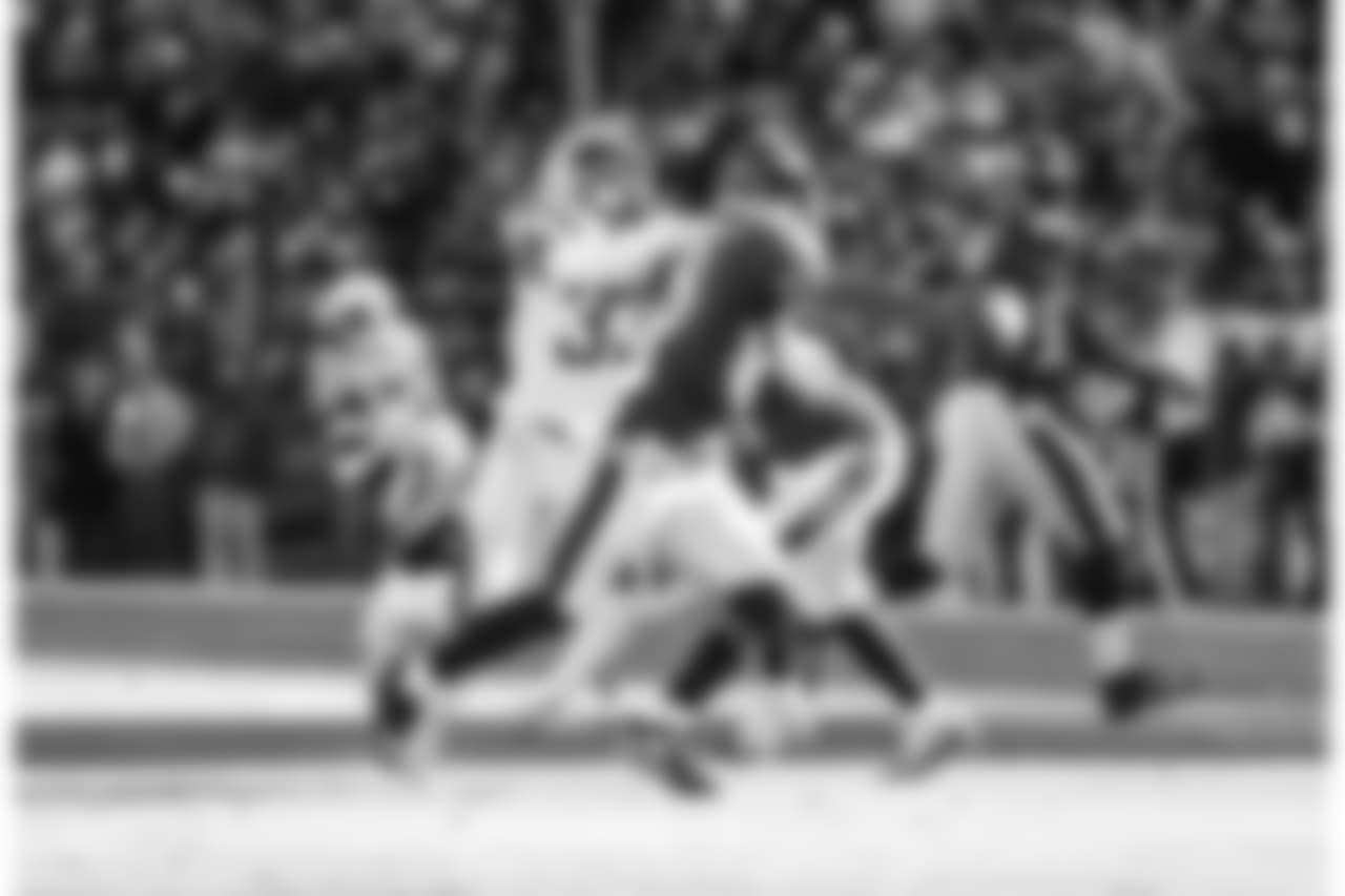 Derwin James runs after QB Lamar Jackson during the Wild Card matchup against the Baltimore Ravens at M&T Bank Stadium.