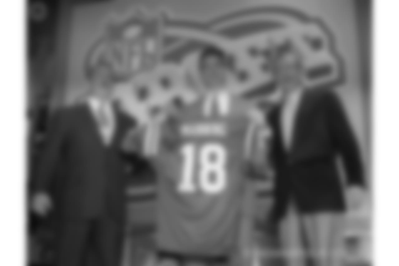 Quarterback Peyton Manning, of Tennissee, holds holds up an Indianapolis Colts jersey as he is flanked by Colts owner Jim Irsay, left, and NFL Commissioner Paul Tagliabue Saturday, April 18, 1998, in New York after being chosen by the Colts as the No. 1 pick in the in draft Saturday. (AP Photo/Adam Nadel)