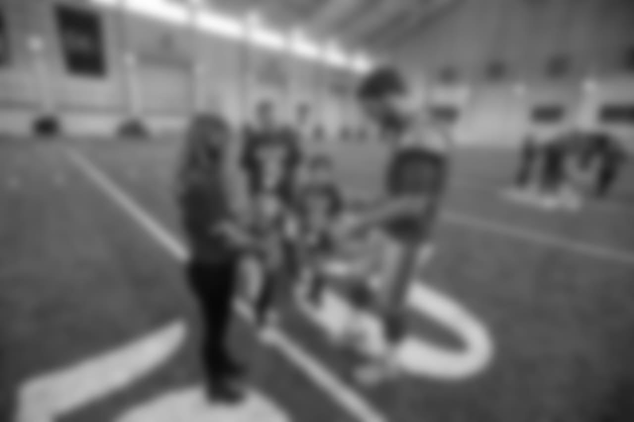 Detroit Lions quarterback Matthew Stafford (9) meets with families from Tragedy Assistance Program For Survivors (TAPS) after the team's walkthrough at the Detroit Lions training facility on Saturday, Nov. 17, 2018 in Allen Park, Mich. (Detroit Lions via AP)