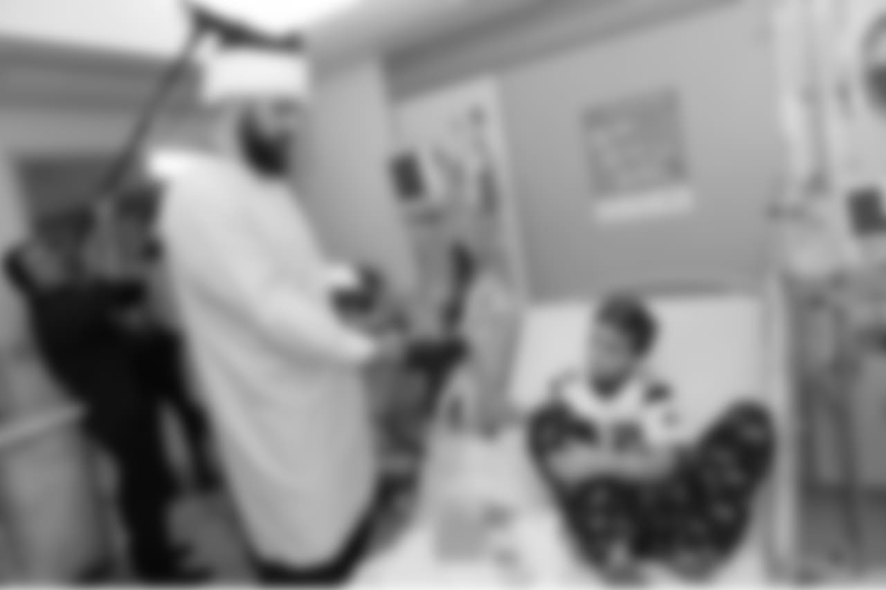 BOSTON, MA - DECEMBER 12: New England Patriot alumni Sebastian Vollmer visits with Mike at Boston Children's Hospital December 12, 2017 in Boston, Massachusetts. (Photo by Darren McCollester/Getty Images for Boston Children's Hospital)