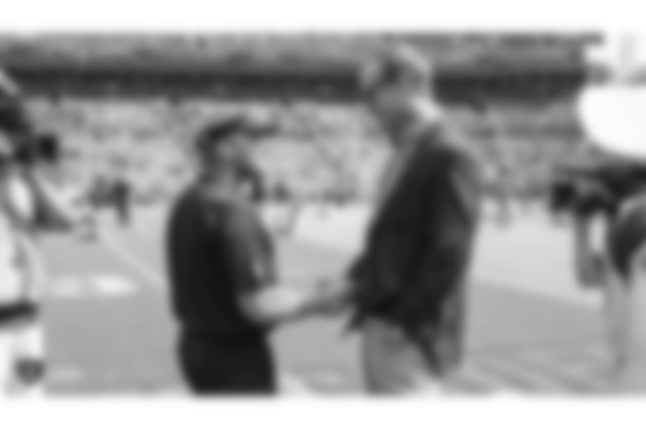 Raiders head coach Jon Gruden and former NFL quarterback Peyton Manning before the Oakland Raiders regular season game against the Broncos in Week 2 at Broncos Stadium at Mile High.