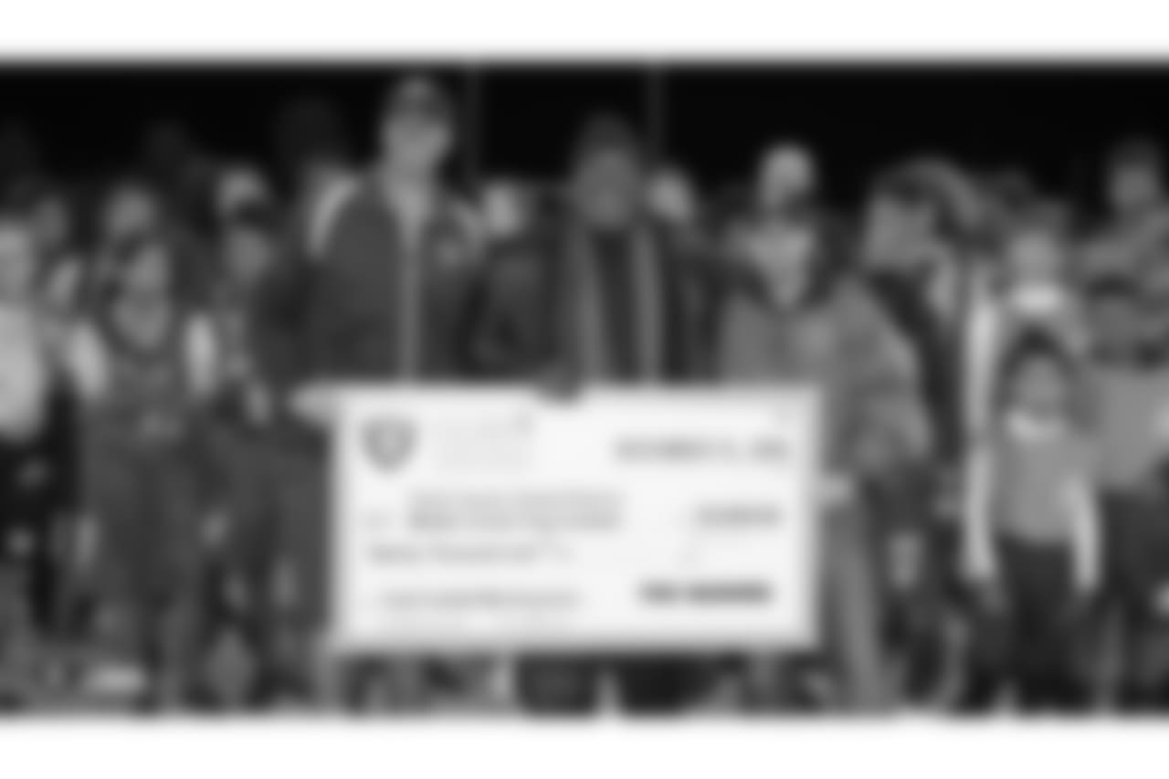 The Clark County District Flag Football league, a collaboration between the Raiders and Clark County School District, is presented with a $20,000 donation from the Raiders, represented by Leo Gray, for new equipment, transportation, officials, and recruiting, Thursday, November 15, 2018, in Las Vegas, Nevada.