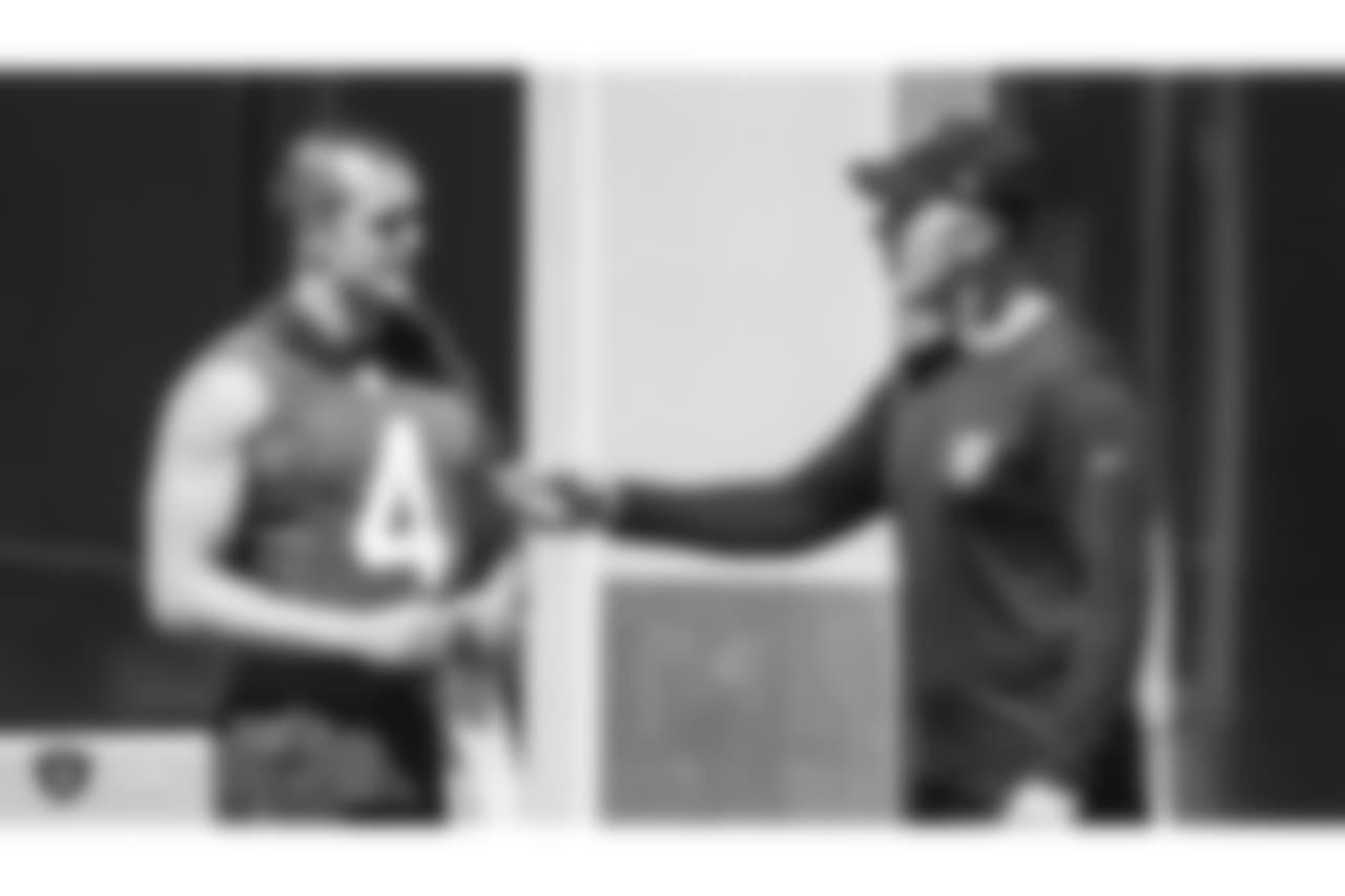 Oakland Raiders quarterback Derek Carr (4) and alumnus Rich Gannon at a Mandatory Minicamp at the Oakland Raiders Practice Facility, Thursday, June 14, 2018, in Alameda, California.
