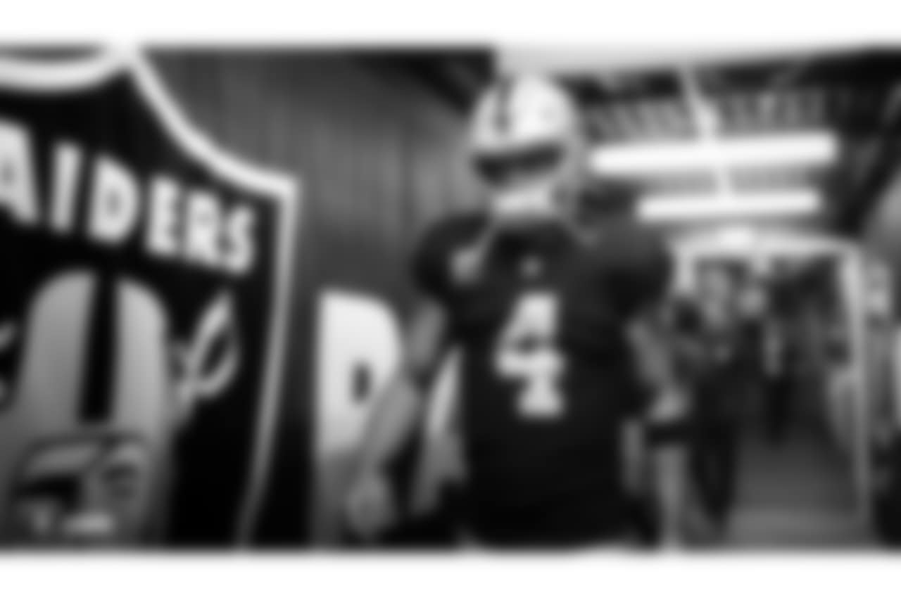 Oakland Raiders quarterback Derek Carr (4) enters the stadium during the Oakland Raiders regular season game against the Los Angeles Rams at Oakland-Alameda County Coliseum, Monday, September 10th in Oakland, California. The Oakland Raiders lost 33-13.