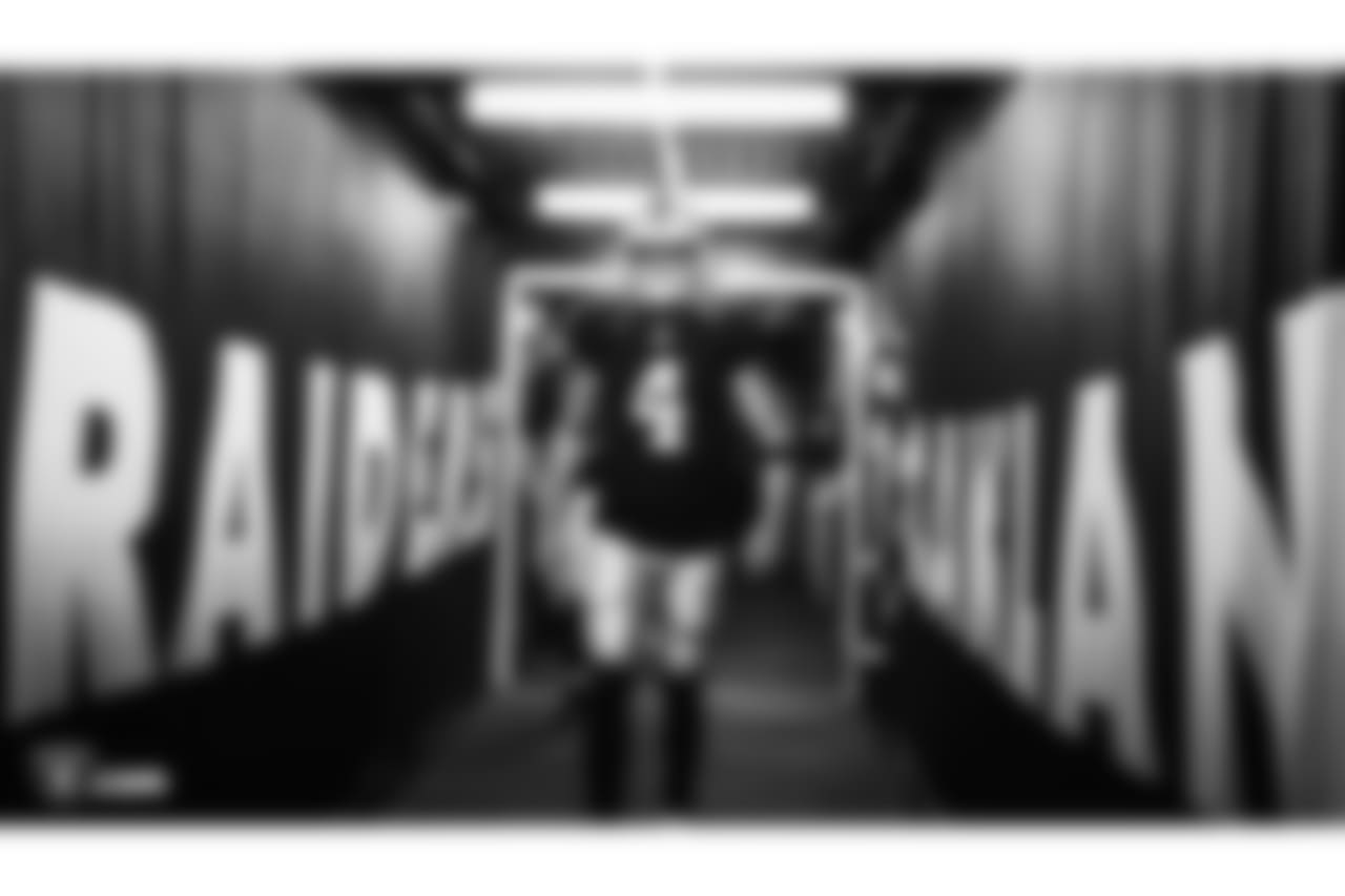Oakland Raiders quarterback Derek Carr (4) walks down the tunnel before the Oakland Raiders preseason game against the Detroit Lions at Oakland-Alameda County Coliseum, Friday, August 10, 2018, in Oakland, California. The Oakland Raiders won 16-10.