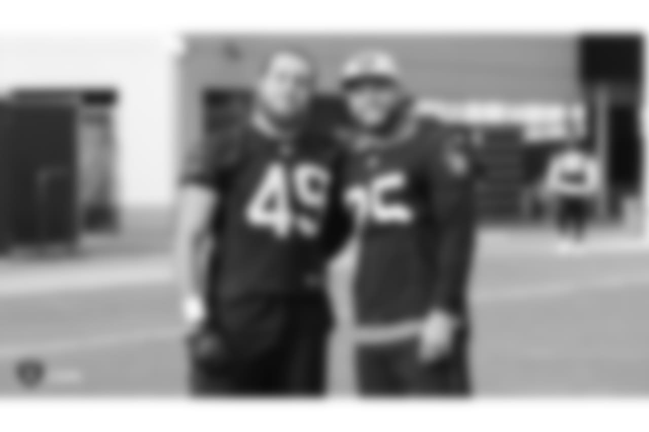 Oakland Raiders linebacker James Cowser (49) and safety Erik Harris (25) on the field for a walk through at the Oakland Raiders Practice Facility, Friday, December 14, 2018, in Alameda, California.