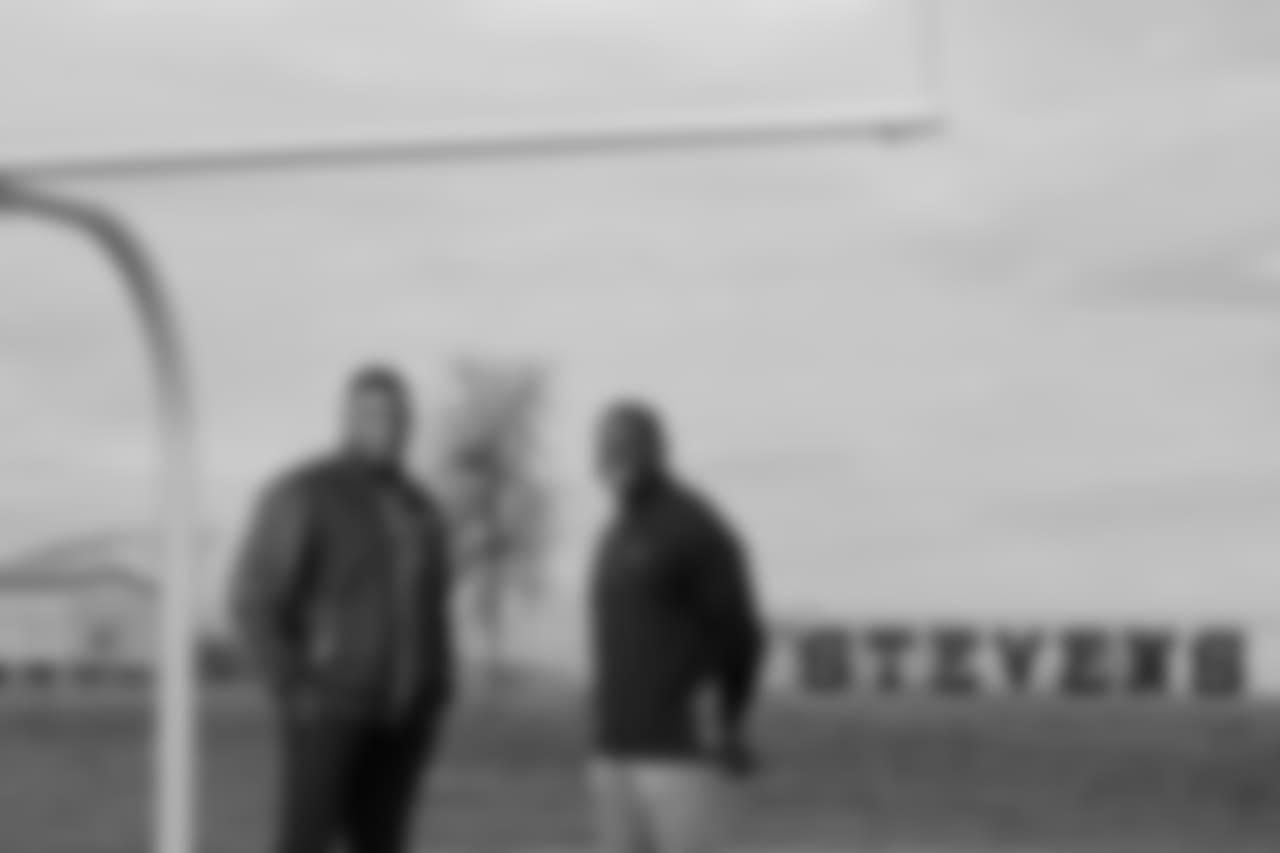 Portrait of Marcus Davenport's father Ron Davenport (left) with Marcus' high school football coach Darryl Hemphill, Wednesday Jan. 9, 2019, on the practice field at John Paul Stevens High School.(Photo By Edward A. Ornelas)