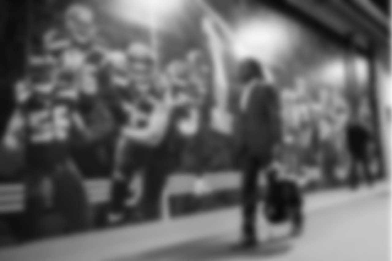 Cornerback Shaquill Griffin arrives at CenturyLink Field and walks past a mural of Seahawks stars adjacent to the locker room.