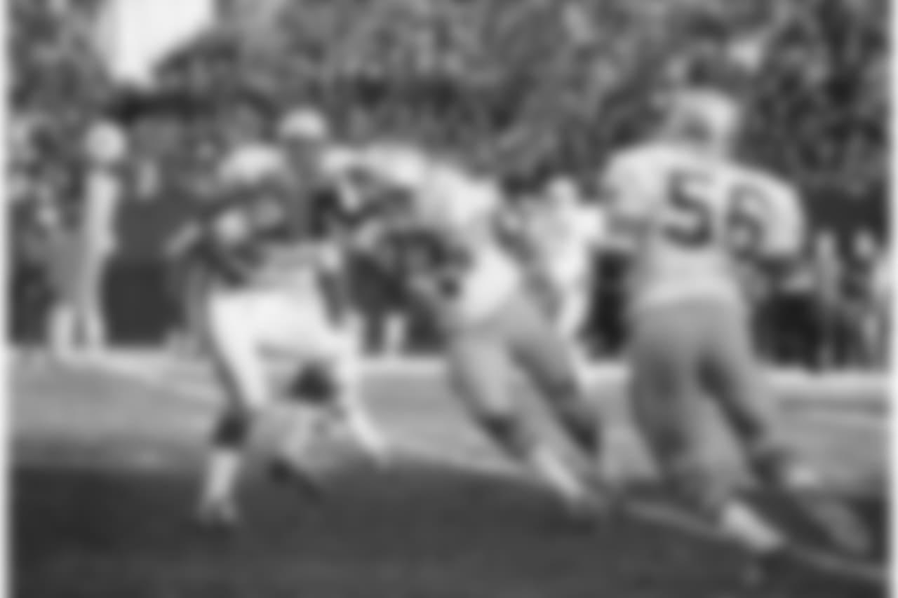 Fran Terkenton, Minnesota Vikings Quarterback, is about to be sacked by Seattle Seahawks tackle Dick Harris (77) on Dec. 14, 1976. (AP Photo)