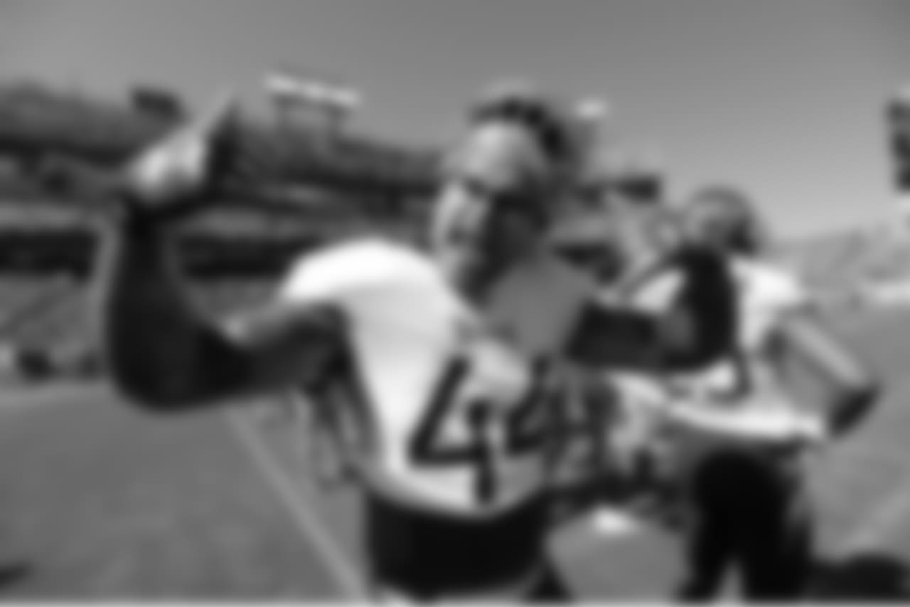 Tennessee Titans linebacker Kamalei Correa (44) jokes for photographers as he warms up before an NFL football game against the Philadelphia Eagles Sunday, Sept. 30, 2018, in Nashville, Tenn. (AP Photo/Mark Zaleski)