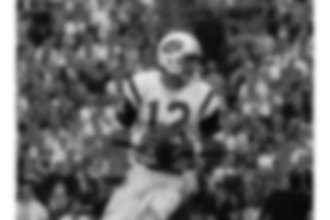 New York Jets quarterback Joe Namath (12) drops back to pass in Super Bowl III, Jan. 12, 1969 in Miami, Fl. (AP Photo)