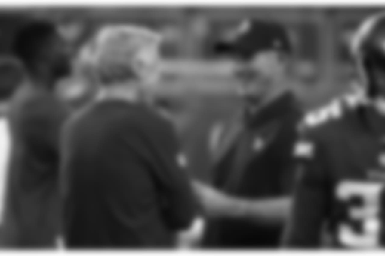 Seattle Seahawks head coach Pete Carroll, left, talks with Minnesota Vikings head coach Mike Zimmer before an NFL preseason football game, Friday, Aug. 24, 2018, in Minneapolis. (AP Photo/Bruce Kluckhohn)