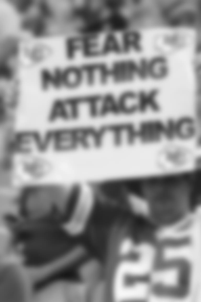 "Chiefs fan holds ""Fear Nothing, Attack Everything"" sign"