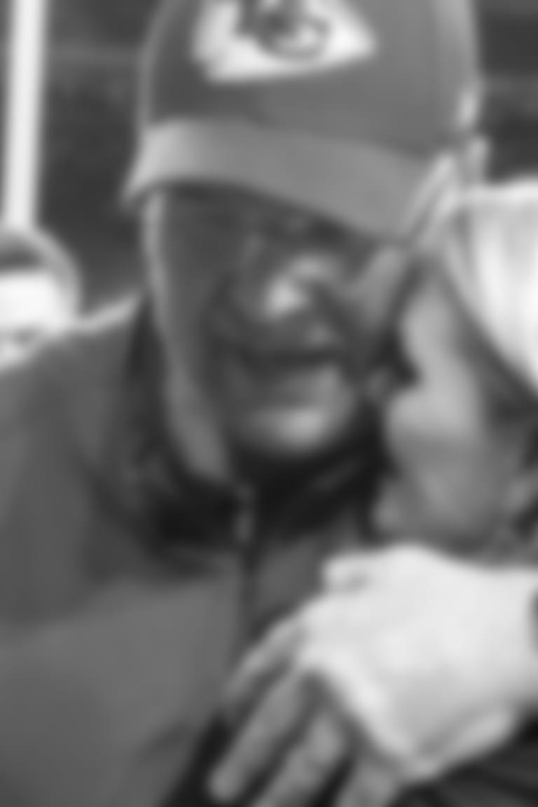 Chiefs head coach Andy Reid hugs wife Tammy Reid