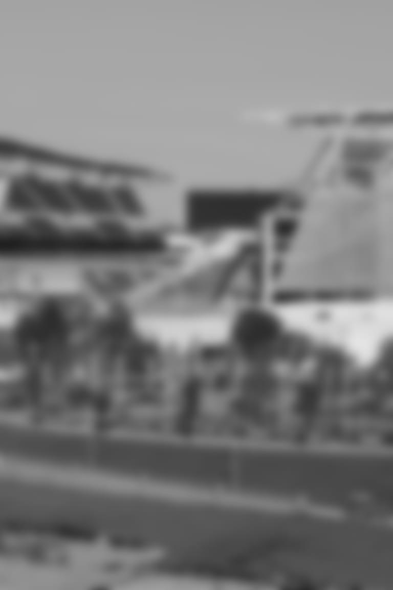 A pedestrian runs through Smale Park on the Ohio River front near Paul Brown Stadium, home of the Cincinnati Bengals NFL Football team, as the team celebrates their 50th anniversary, Thursday, Sept. 28, 2017, in Cincinnati. (AP Photo/John Minchillo)