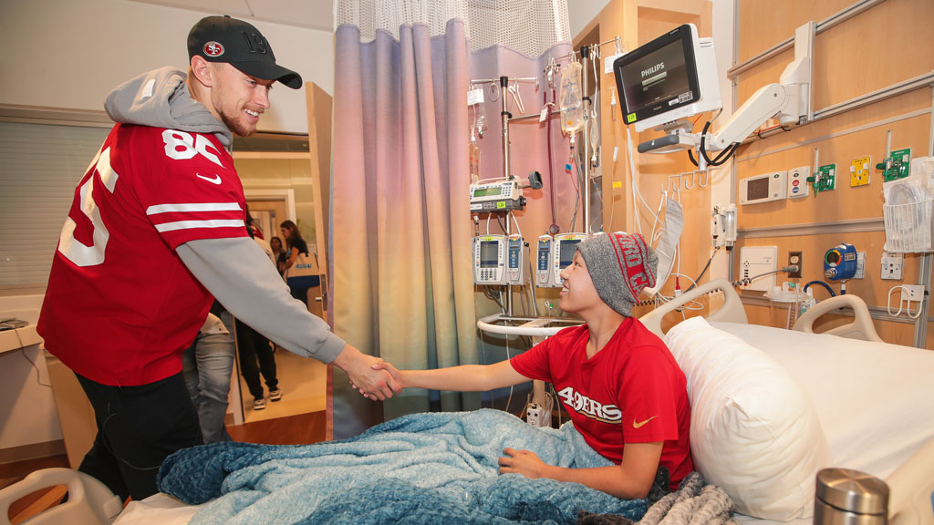 December 26: George Kittle and Teammates Hand Out JoyJars to Brighten Spirits at a Local Children's Hospital